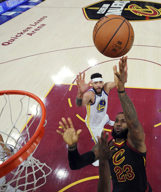 . Cleveland Cavaliers\' LeBron James shoots as Golden State Warriors\' JaVale McGee watches during the first half of Game 3 of basketball\'s NBA Finals, Wednesday, June 6, 2018, in Cleveland. (Gregory Shamus/Pool Photo via AP)