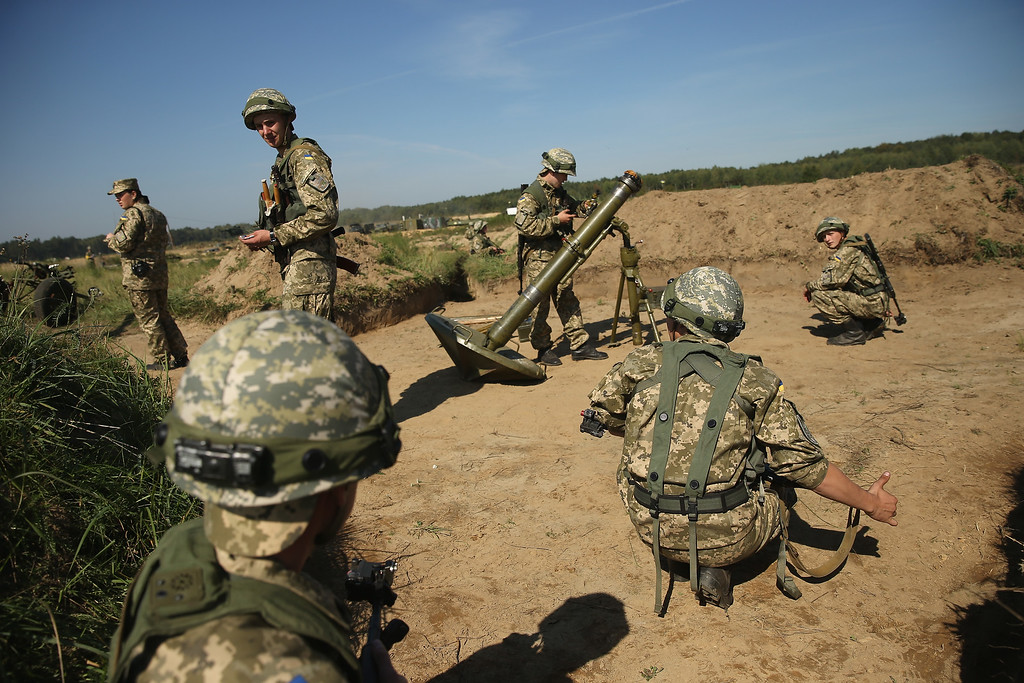 ". Ukrainian marines train with a heavy mortar on the second day of the ""Rapid Trident\"" NATO military exercises on September 16, 2014 near Yavorov, Ukraine.   (Photo by Sean Gallup/Getty Images)"