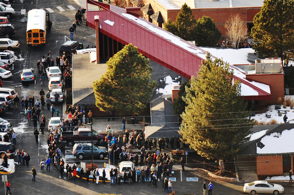 . People gather out side of Shepherd of the Hills Lutheran Church school, one of the reunification centers, with their families following a shooting incident at Arapahoe High School. A student who carried a shotgun into Arapahoe High School and asked where to find a specific teacher and opened fire in Littleton, Colorado. December 13, 2013. (Photo by Hyoung Chang/The Denver Post)