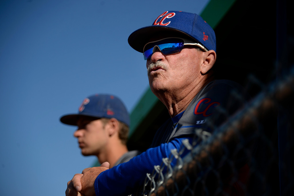 . Aurora, CO - APRIL 08: Head coach Marc Johnson of the Cherry Creek Bruins watches the action against the Overland Trailblazers during the second inning. Johnson won his 700th career game as the Bruins visited the Overland Trailblazers. Overland hosted Cherry Creek on Tuesday, April 8, 2014. (Photo by AAron Ontiveroz/The Denver Post)