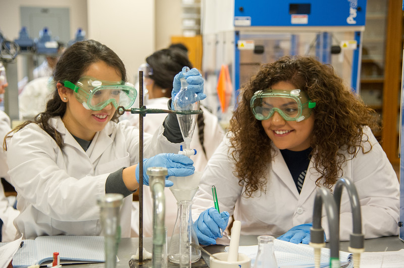 Mayra Rodriguez(left) and Anyssa Villanueva during the process of extract and purify caffeine from coffee filter.