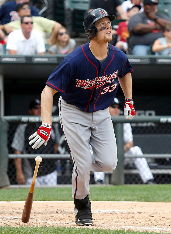 . The Twins\' Justin Morneau watches his home run off Chicago White Sox relief pitcher Ramon Troncoso during the ninth inning of their game Friday, Aug. 9, 2013, in Chicago. (AP Photo/Charles Rex Arbogast)