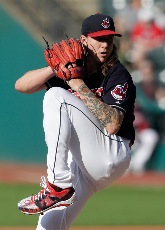 . Cleveland Indians starting pitcher Mike Clevinger delivers in the first inning of a baseball game against the Houston Astros, Thursday, May 24, 2018, in Cleveland. (AP Photo/Tony Dejak)