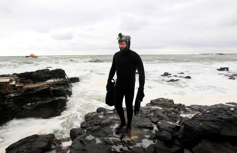 . A man in fancy dress takes part in a charity event to celebrate Saint Patrick\'s Day and raise money for local charities in the town of Portstewart County, Londonderry March 17, 2013. REUTERS/Cathal McNaughton