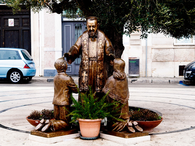 In the Piazza Umberto sits Padre Pio.