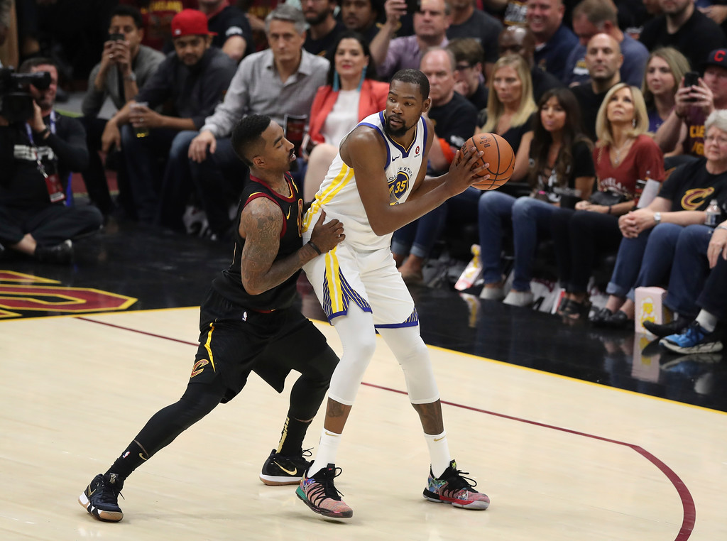 . Golden State Warriors\' Kevin Durant is defended by Cleveland Cavaliers\' JR Smith in the first half of Game 4 of basketball\'s NBA Finals, Friday, June 8, 2018, in Cleveland. (AP Photo/Carlos Osorio)