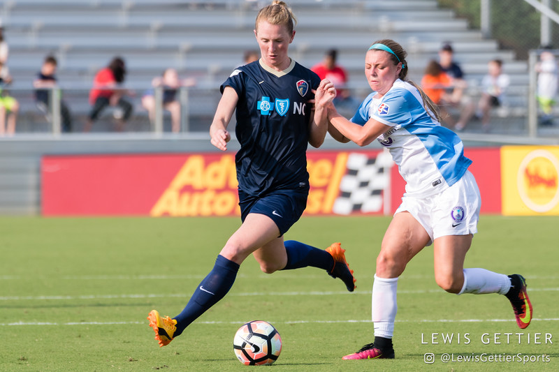 Samantha Mewis (5) and Danica Evans (8) during a match between the NC Courage and the Orlando Pride in Cary, NC in Week 3 of the 2017 NWSL season. Photo by Lewis Gettier.