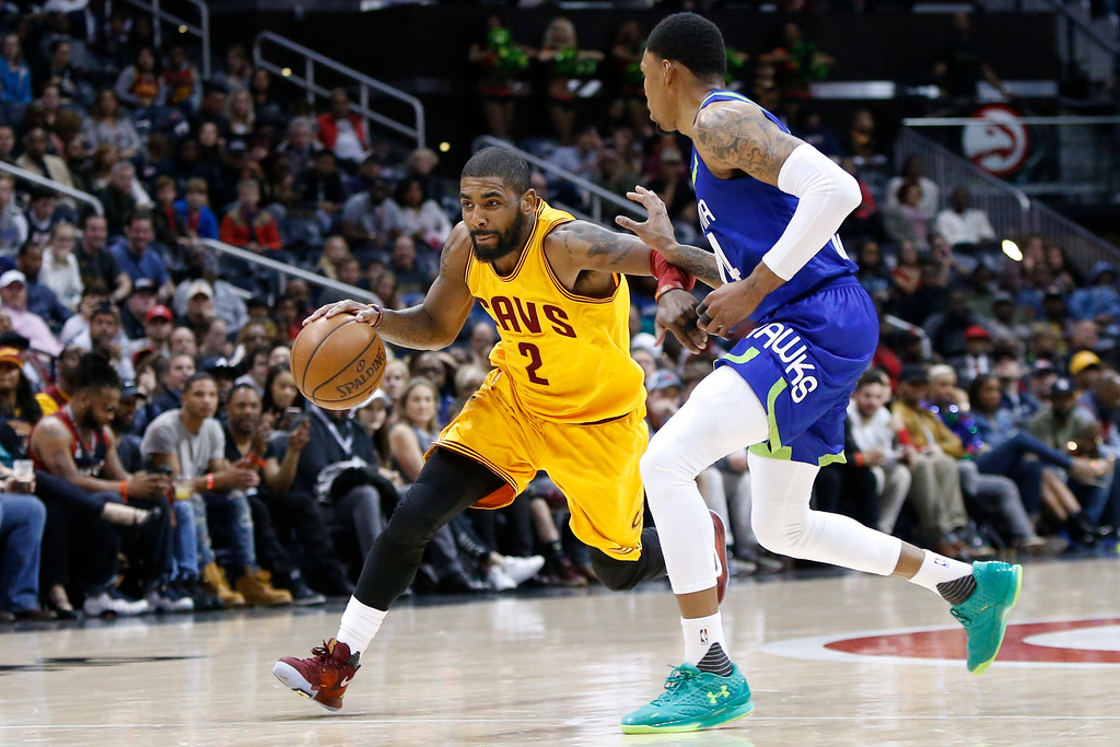 . Cleveland Cavaliers guard Kyrie Irving (2) drives to the basket against the Atlanta Hawks in the second half of an NBA basketball game, Friday, March 3, 2017, in Atlanta. The Cavaliers won 135-130. (AP Photo/Brett Davis)