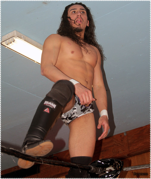 """Gabriel Skye of The Nightcrawlers checks out the fan reaction following their """"heel turn"""" during the Test Of Strength Wrestling """"Dear Norma"""" event held on April 3, 2021 at Riders Smokehouse Bar and Grill in Thomaston, Connecticut."""