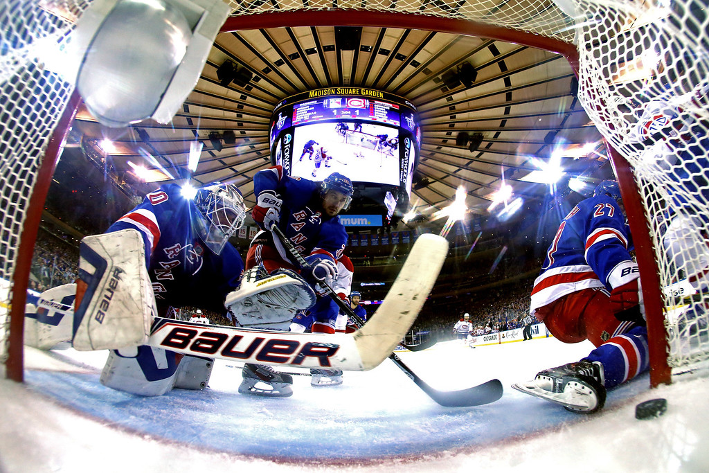 . Henrik Lundqvist #30 of the New York Rangers watches Daniel Briere #48 of the Montreal Canadiens (not pictured) goal into the back of the net in Game Three of the Eastern Conference Final during the 2014 NHL Stanley Cup Playoffs at Madison Square Garden on May 22, 2014 in New York City.  (Photo by Al Bello/Getty Images)