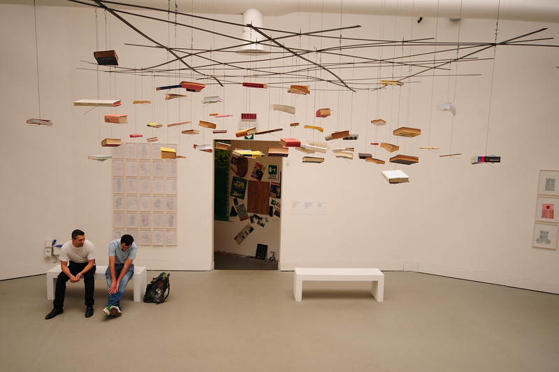 Richard Wentworth: Untitled. 2009 Installation, books, iron and steel cable (hanging books)
