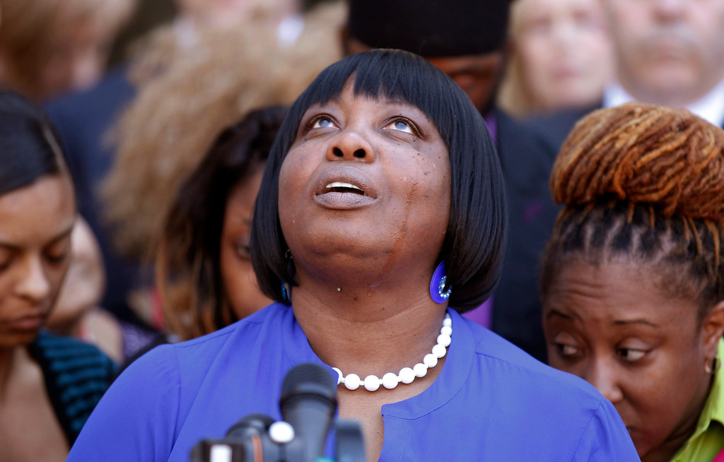 . Ursula Ward, mother of shooting victim Odin Lloyd, looks up to the heavens as she talks about her deceased son outside Bristol County Superior Court Wednesday, April 15, 2015, in Fall River, Mass., after former New England Patriots football player Aaron Hernandez was found guilty of murder in the shooting death of Odin Lloyd. (AP Photo/Stew Milne)