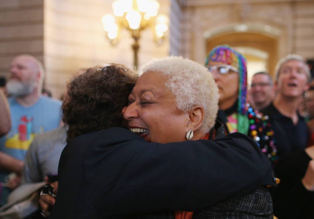 . A couple celebrate upon hearing the U.S. Supreme Court has struck down the Defense of Marriage Act at City Hall June 26, 2013, in San Francisco, United States. The high court ruled on DOMA, and will rule on California\'s Prop 8 as well.  (Justin Sullivan/Getty Images)