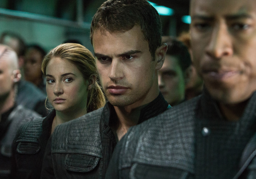""". This image released by Summit Entertainment shows Shailene Woodley, left, and Theo James in a scene from \""""Divergent.\"""" (AP Photo/Summit Entertainment, Jaap Buitendijk)"""