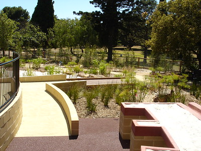 raised sandpit with accessible bays and timber ramp