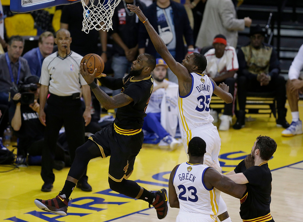 . Cleveland Cavaliers forward LeBron James, left, shoots against Golden State Warriors forward Kevin Durant (35) during the second half of Game 5 of basketball\'s NBA Finals in Oakland, Calif., Monday, June 12, 2017. (AP Photo/Ben Margot)