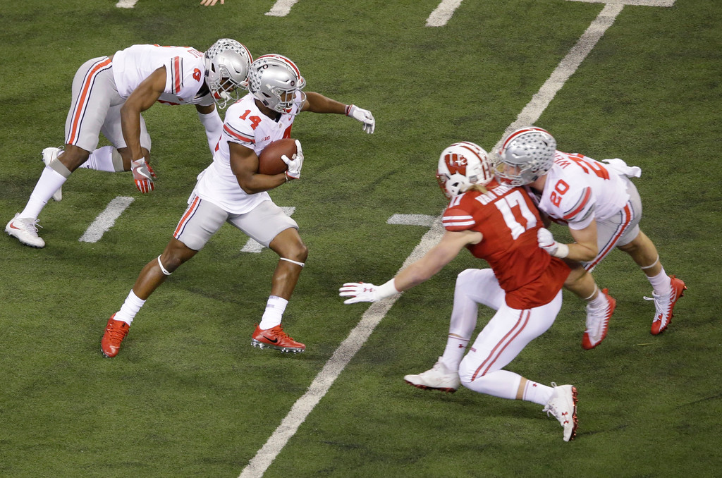. Ohio State wide receiver K.J. Hill (14) runs with the ball during the first half of the Big Ten championship NCAA college football game against Wisconsin, Saturday, Dec. 2, 2017, in Indianapolis. (AP Photo/AJ Mast)