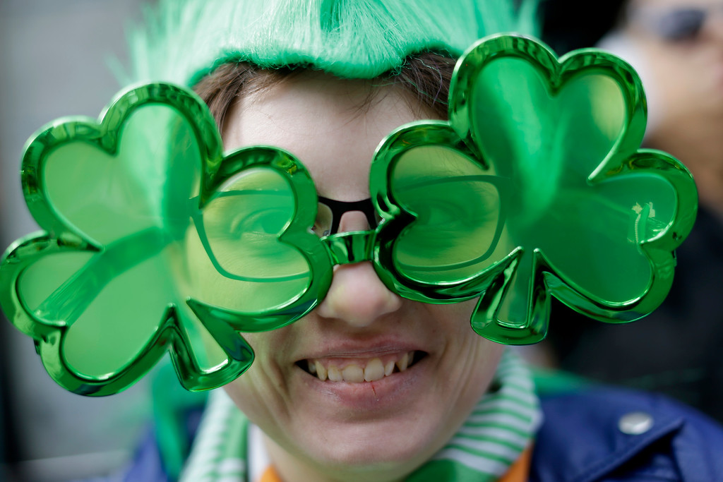 . Caitlin Neal-Karhut, of Seaford, N.Y., smiles as she watches the St. Patrick\'s Day Parade, Tuesday, March 17, 2015, in New York.  (AP Photo/Mary Altaffer)