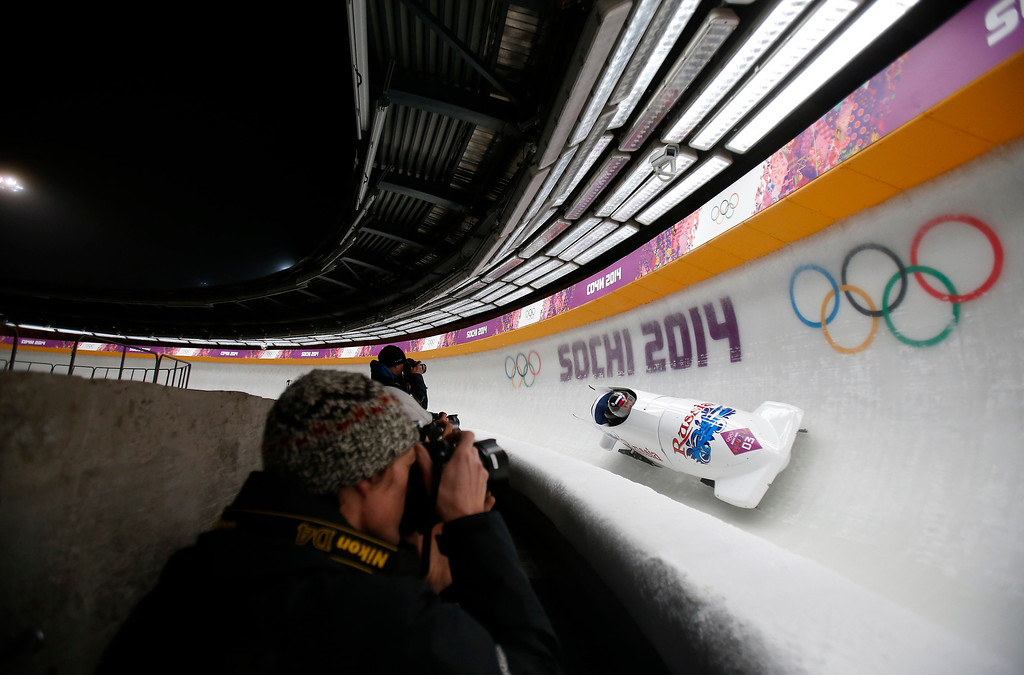 . Russia\'s Alexander Zubkov and Alexey Voevoda head down turn five for the Two-man Bobsleigh at the Sanki Sliding Center for the 2014 Winter Olympics in Krasnaya Polyana, Russia, on Sunday, Feb. 16, 2014.  (Nhat V. Meyer/Bay Area News Group)