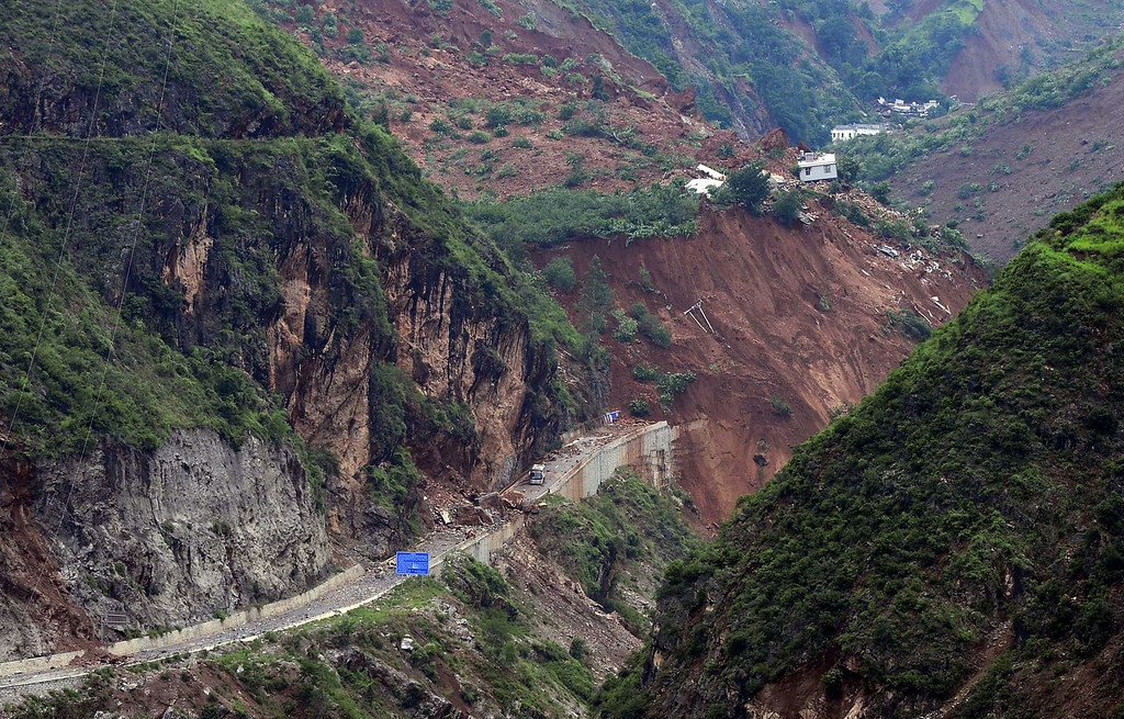 . This photo taken on August 4, 2014 shows an overhead view of a road buried by landslide after a 6.1 magnitude earthquake hit Ludian county in Zhaotong, in southwest China\'s Yunnan province.   AFP PHOTOSTR/AFP/Getty Images