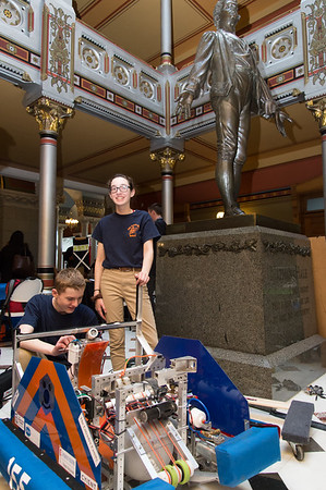 04/24/19 Wesley Bunnell | Staff A Student-Manufacturer Connection Fair was held on Wednesday at the State Capitol Building connecting over 500 students and dozens of Connecticut companies to explore careers in advanced manufacturing. Members of the FIRST Robotics Program's Berlin First- The Techno-nuts next to a robot built by the program from a previous season which was designed to shoot a ball about 13 feet high into a castle wall opening. Michael Bryant, L, and Melanie Mouser.