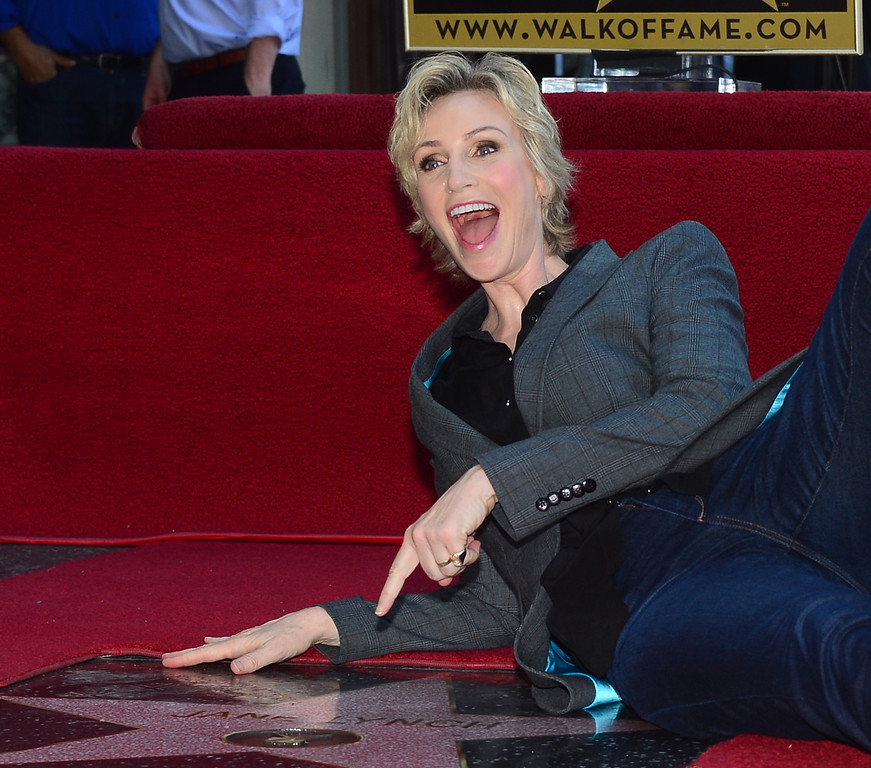 . Actress Jane Lynch poses on her \'Star\' during a cermony honoring her with the 2,505 Star on the Hollywood Walk of Fame in the category of television on September 4, 2013 in Hollywood, California.       ( FREDERIC J. BROWN/AFP/Getty Images)