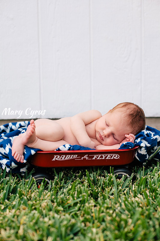 Newborn portrait of baby Daniel in a miniature Radio Flyer wagon | Photo by Mary Cyrus Photography in Dallas, Texas