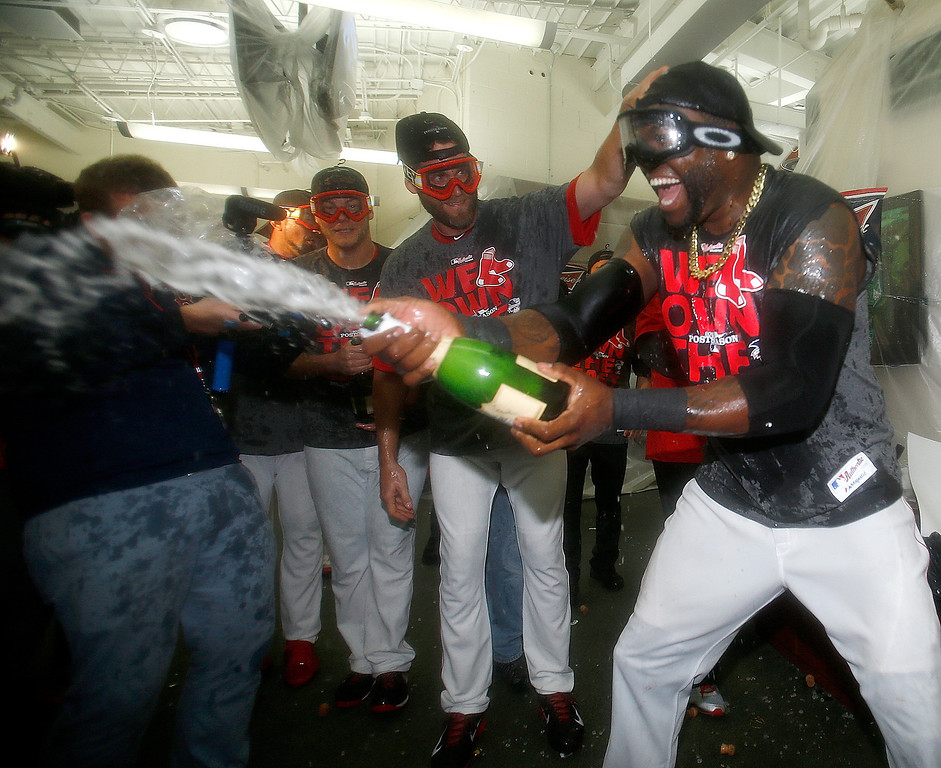 . BOSTON, MA - SEPTEMBER 20: David Ortiz #34 of the Boston Red Sox celebrates with teammates after winning the AL East Division by beating  the Toronto Blue Jays at Fenway Park on September 20, 2013 in Boston, Massachusetts.  (Photo by Jim Rogash/Getty Images)