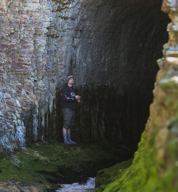 . Eric Thomas, on vacation from Anchorage, Alaska, stands inside a manmade tunnel that connects San Vicente Creek to the Pacific Ocean in Davenport, Calif., on Wednesday, Jan 16, 2013. (John Green/Staff)