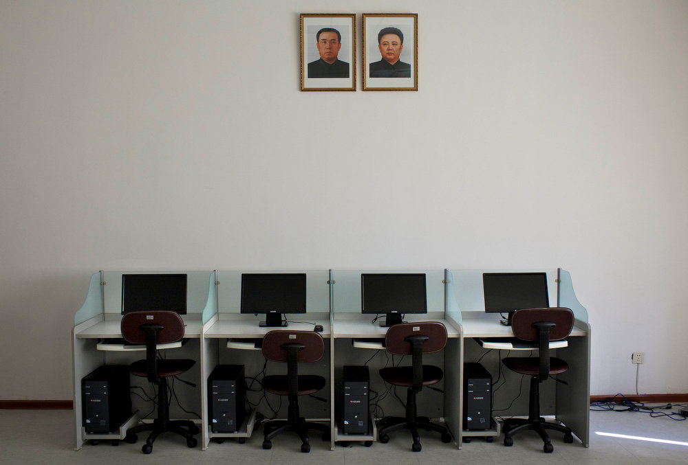 ". Portraits of North Korea\'s late leaders Kim Il Sung and Kim Jong Il hang on a wall over a bank of computers at Pyongyang University of Science and Technology on Wednesday, Oct. 5, 2011. A quasi-religious mystique surrounding the Kim family has been developed over two generations, dating back to ""eternal president\"" Kim Il Sung.  (AP Photo/David Guttenfelder)"