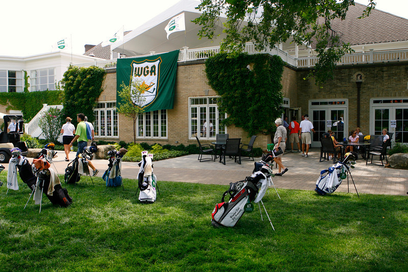 Players golf bags sit in front of North Shore Country Club during the first round Tuesday.