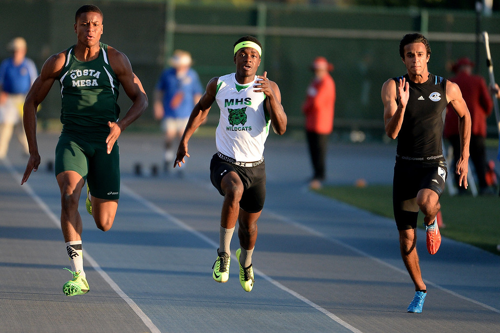 . Costa Mesa\'s Quinton Bell, left, Monrovia\'s Cravon Gillespie, center, Camarillo\'s Ahmed Obed, right, competes in the 100 meter dash during the CIF-SS Masters Track and Field meet at Falcon Field on the campus of Cerritos College in Norwalk, Calif., on Friday, May 30, 2014.   (Keith Birmingham/Pasadena Star-News)