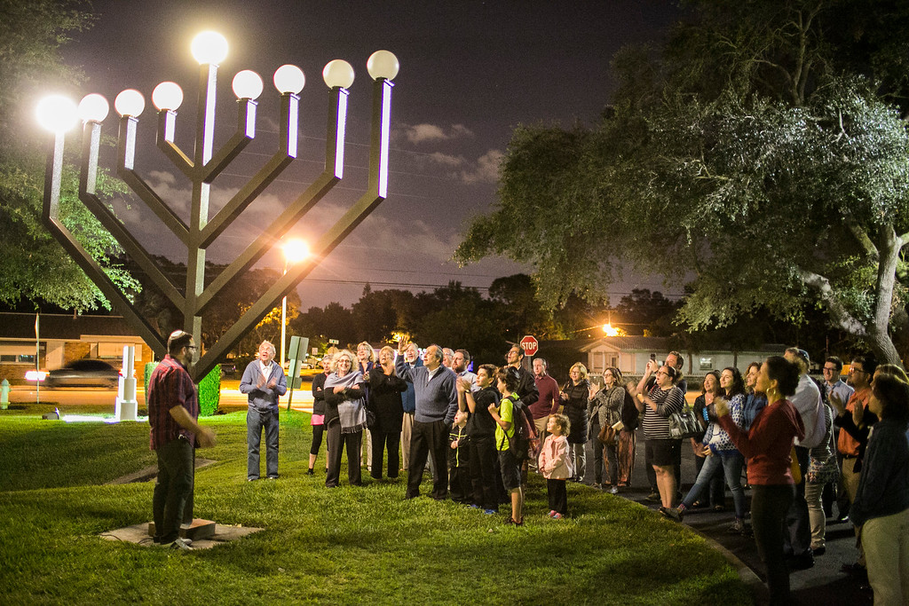 . Members of Congregation B\'nai Israel of St. Petersburg celebrate lighting a Menorah in St. Petersburg, Fla., Tuesday, Dec. 12, 2017. (Eve Edelheit/Tampa Bay Times via AP)