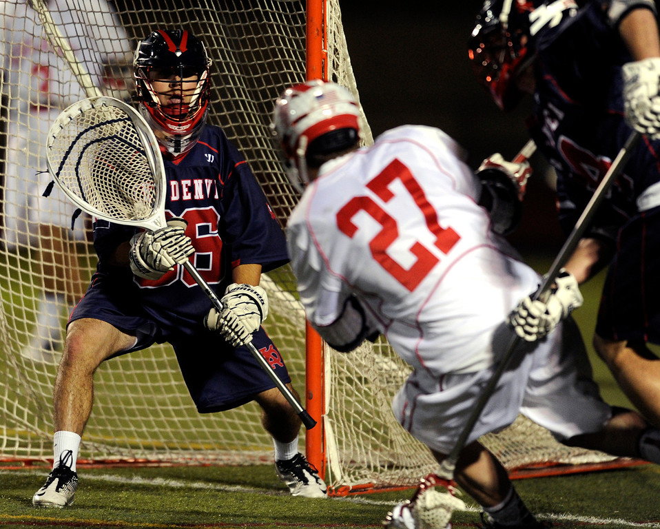 . AURORA, CO. - APRIL 24:  Sun Devils goalie Marcus Stears (36) anticipated a shot from Raiders attack Alec Barnes (27) in the second half. The Raiders celebrated after holding on to beat Kent despite a late comeback attempt by the Sun Devils.  The Regis Jesuit High School boy\'s lacrosse team defeated Kent Denver 10-8 Wednesday night, April 24, 2013. Photo By Karl Gehring/The Denver Post