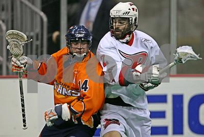 1/10/2009 - Ryan Boyle drives against Jon Durno - Boston Blazers @ NY Titans - Prudential Center - Newark, NJ