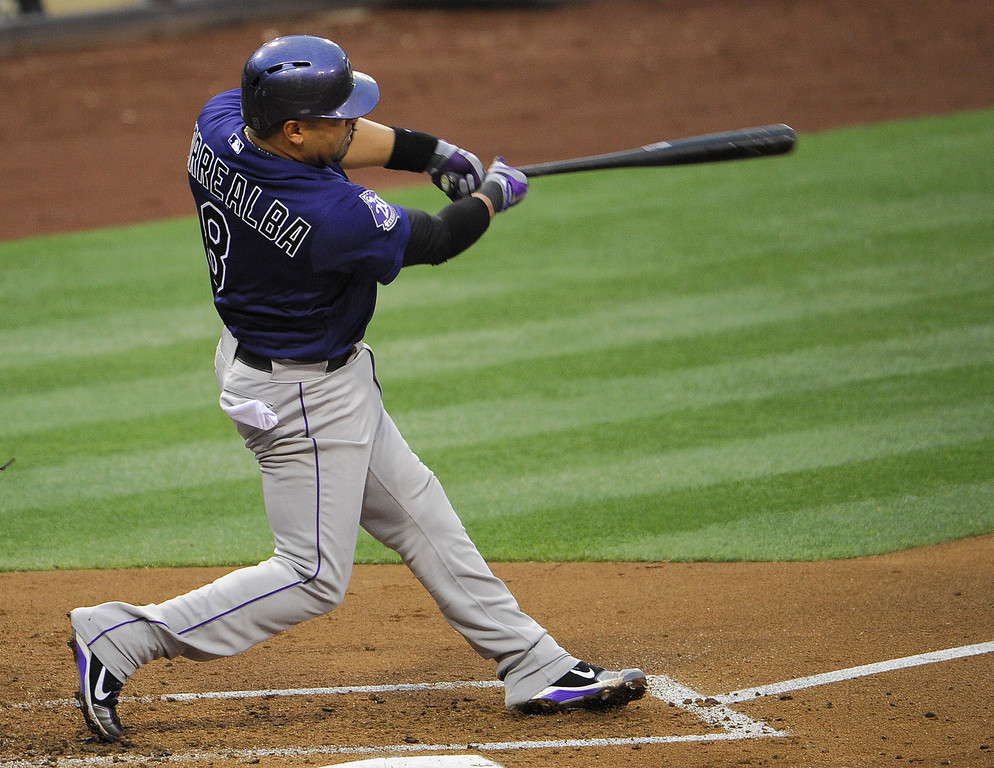 . Yorvit Torrealba #8 of the Colorado Rockies hits a double during the second inning of a baseball game against the San Diego Padres at Petco Park on July 10, 2013 in San Diego, California.  (Photo by Denis Poroy/Getty Images)