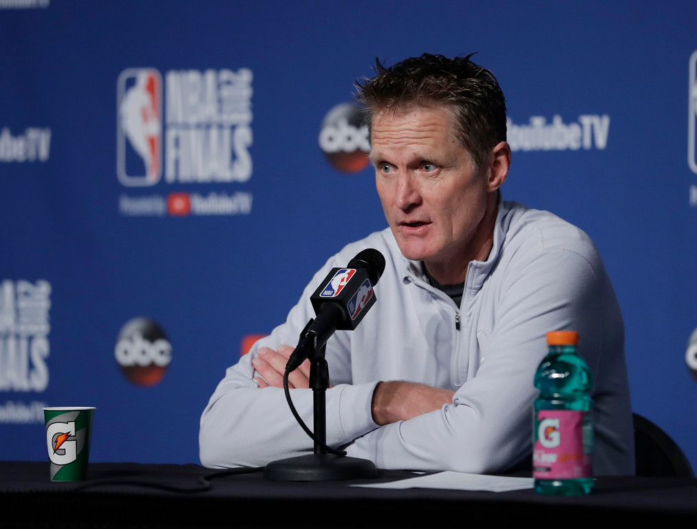 . Golden State Warriors coach Steve Kerr speaks to reporters after the Warriors defeated the Cleveland Cavaliers 108-85 in Game 4 of basketball\'s NBA Finals to win the NBA championship, early Saturday, June 9, 2018, in Cleveland. (AP Photo/Tony Dejak)