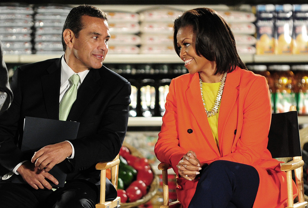. US First Lady Michelle Obama (R) and Los Angeles Mayor Antonio Villaraigosa  speak  in Inglewood, California on February 1, 2012. (FREDERIC J. BROWN/AFP/Getty Images)