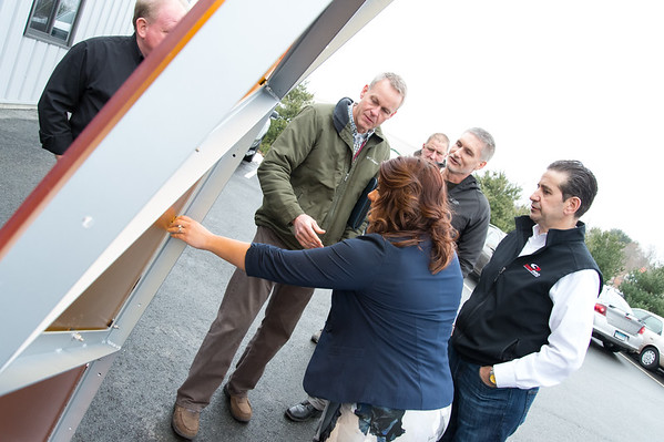 02/15/19 Wesley Bunnell | Staff City Engineer Robert Trottier, Director of Public Works Mark Moriarty, Mayor Erin Stewart, and Sign Pro President Peter Rappoccio look over a colored plexiglass trim piece which is to be installed on the Beehive Bridge project. She visited the manufacturer, Sign Pro, along with other city employees on Friday for a project update.