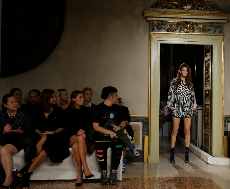 . A model wears a creation for Emilio Pucci women\'s Spring-Summer 2014 collection, part of the Milan Fashion Week, unveiled in Milan, Italy, Saturday, Sept. 21, 2013. (AP Photo/Luca Bruno)