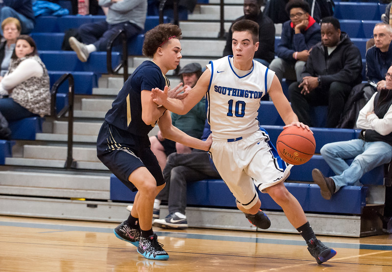 01/14/19  Wesley Bunnell | Staff  Newington boys basketball defeated Southington at Southington High School on Monday night. Jared Kelly (10) guarded by Izayah Ciarcia (3).