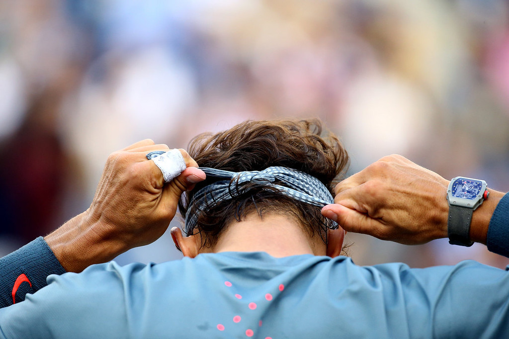 . Rafael Nadal of Spain ties his bandana during a break in his men\'s singles final match against Novak Djokovic of Serbia on Day Fifteen of the 2013 US Open at the USTA Billie Jean King National Tennis Center on September 9, 2013 in the Flushing neighborhood of the Queens borough of New York City.  (Photo by Al Bello/Getty Images)