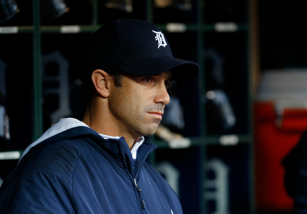 . Detroit Tigers manager Brad Ausmus watches from the dugout against the Houston Astros in the first inning of a baseball game in Detroit Wednesday, May 7, 2014. (AP Photo/Paul Sancya)