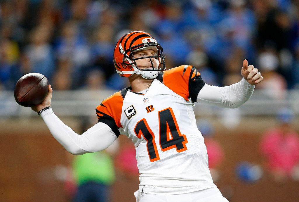. Cincinnati Bengals quarterback Andy Dalton throws against the Detroit Lions in the first quarter of an NFL football game Sunday, Oct. 20, 2013, in Detroit. (AP Photo/Rick Osentoski)