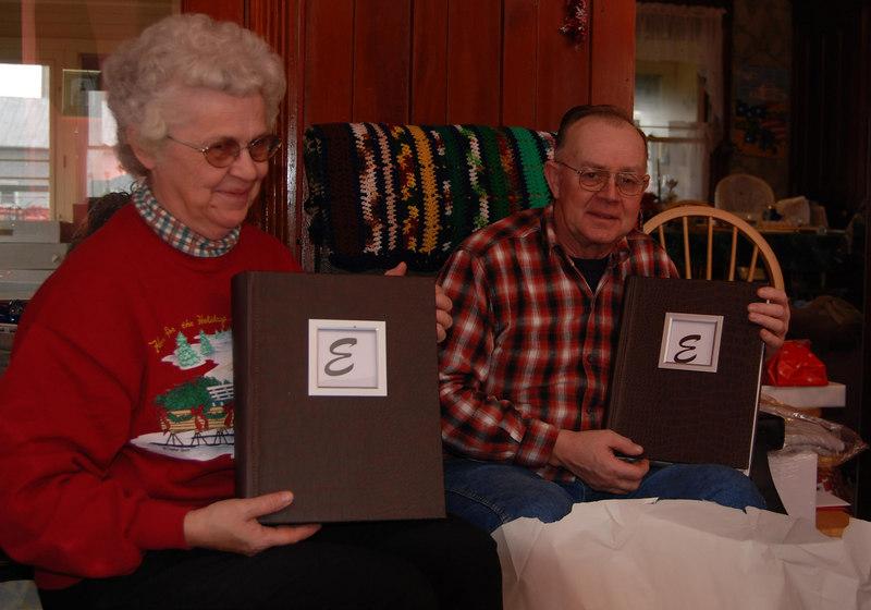 Ellen's parents opening their photo albums that Ellen made