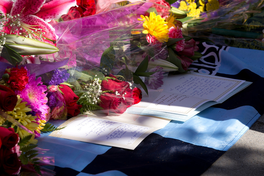 . Flowers and cards pile up in a makeshift shrine at the scene outside Library Gardens apartment complex, where a balcony collapsed, sending 13 people plunging to the street below, Tuesday, June 16, 2015, in Berkeley, Calif. Six people were killed, and seven more were transported to area hospitals. (D. Ross Cameron/Bay Area News Group)