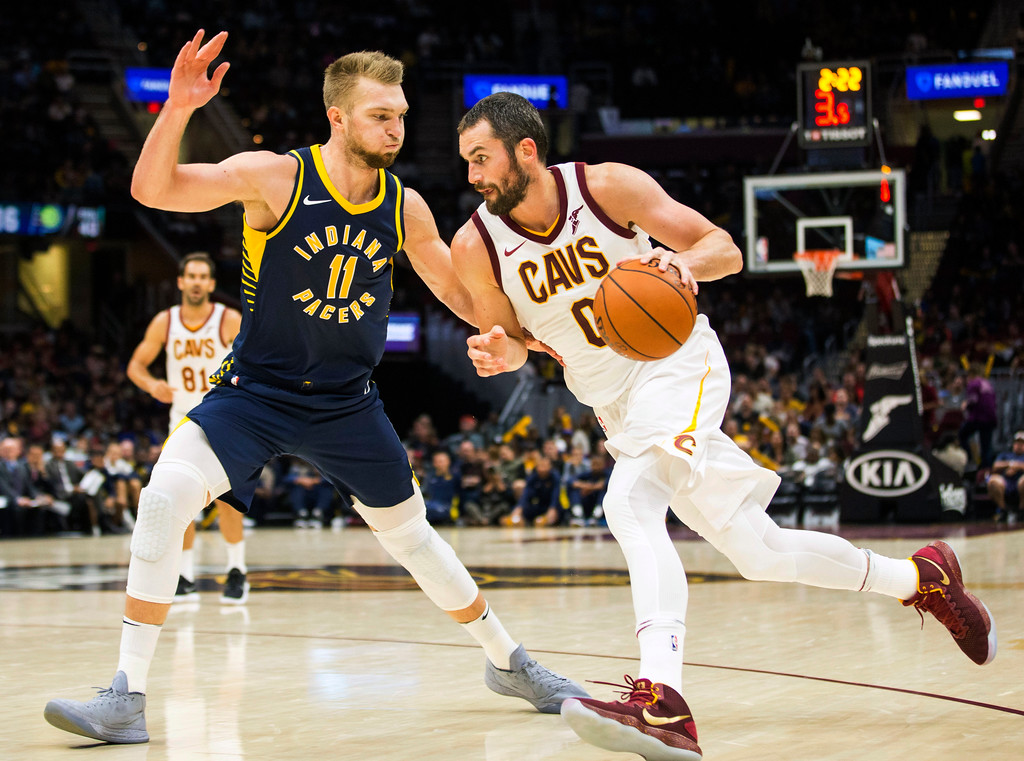 . Cleveland Cavaliers\' Kevin Love (0) dribbles around Indiana Pacers\' Domantas Sabonis (11) during the second quarter of an NBA preseason basketball game, Friday, Oct. 6, 2017, in Cleveland. (AP Photo/Scott R. Galvin)
