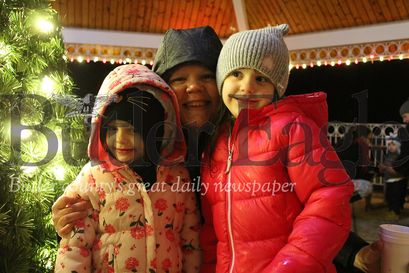 """Winslow (left), Lynnette (center) and Perri (right) Glaze all enjoyed Santa's Workshop Saturday night in Alameda Park. Winslow loved the lights, while Lynnette and Perri loved the music.""Photo by Samantha Beal."