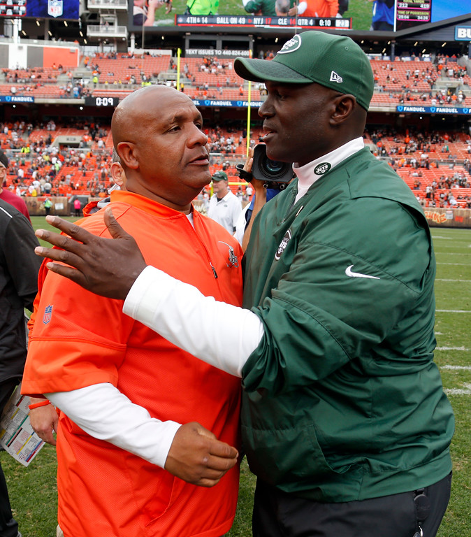 . Cleveland Browns head coach Hue Jackson, left, and New York Jets head coach Todd Bowles talk after the Jets defeated the Browns in an NFL football game, Sunday, Oct. 8, 2017, in Cleveland. (AP Photo/Ron Schwane)