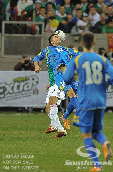 Bosnia-Herzegovina's Forward Vedad Ibisevic (#14) attempts a header during Soccer action between Bosnia-Herzegovina and Mexico.  Mexico defeated Bosnia-Herzegovina 2-0 in the game at the Georgia Dome in Atlanta, GA.